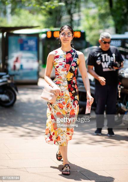 Caroline Issa wearing dress with floral print is seen outside Sunnei during Milan Men's Fashion Week Spring/Summer 2019 on June 17 2018 in Milan Italy