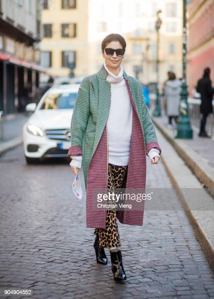 Caroline Issa wearing leopard print pants green checked coat is seen outside MSGM during Milan Men's Fashion Week Fall/Winter 2018/19 on January 14...