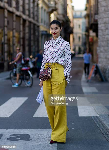 Caroline Issa wearing mustard pants and button shirt outside Jil Sander during Milan Fashion Week Spring/Summer 2017 on September 24 2016 in Milan...