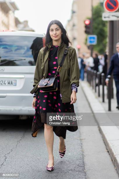 Caroline Issa wearing Prada bag olive jacket dress with dots outside Rodarte during Paris Fashion Week Haute Couture Fall/Winter 20172018 Day One on...