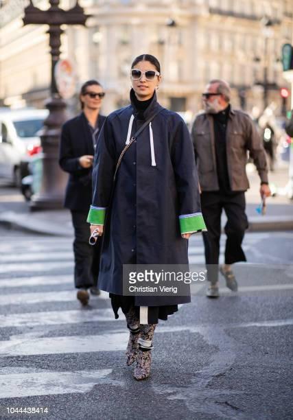 Caroline Issa wearing trench coat is seen outside Stella McCartney during Paris Fashion Week Womenswear Spring/Summer 2019 on October 1 2018 in Paris...