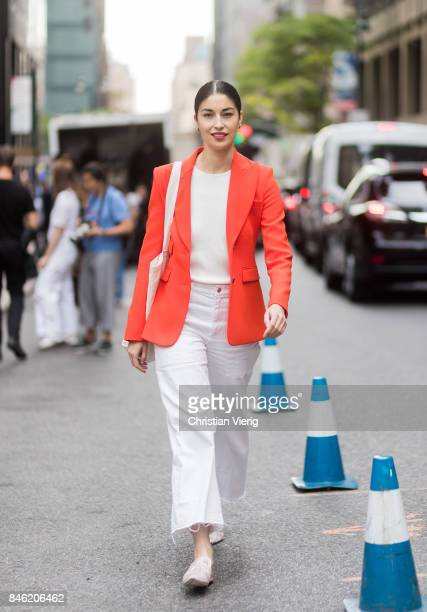 Caroline Issa wearing white pants red jacket seen in the streets of Manhattan outside Gabriela Hearst during New York Fashion Week on September 12...