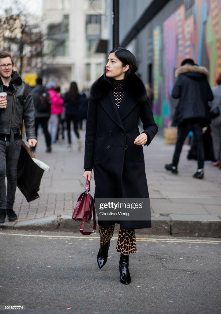 Caroline Issa wearing wool coat during London Fashion Week Men's January 2018 on January 6, 2018 in London, England.