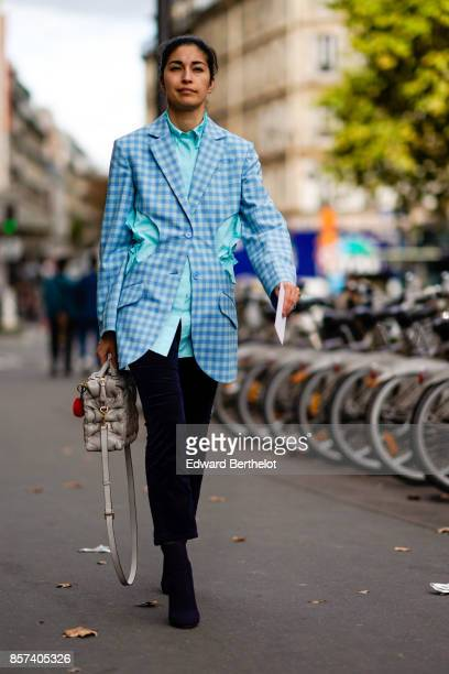 Caroline Issa wears a blue checkered blazer jacket outside Thom Browne during Paris Fashion Week Womenswear Spring/Summer 2018 on October 3 2017 in...