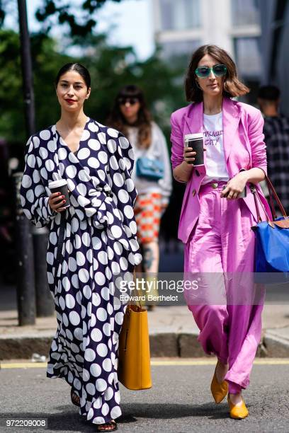 Caroline Issa wears a dress with polka dots during London Fashion Week Men's June 2018 on June 09 2018 in London England