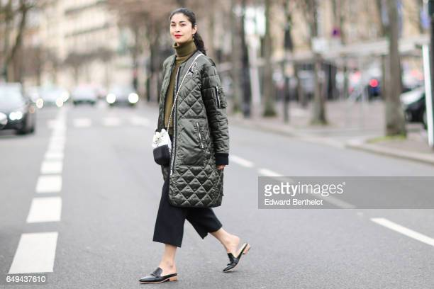 Caroline Issa wears a khaki long puffer jacket outside the Ellery show during Paris Fashion Week Womenswear Fall/Winter 2017/2018 on March 7 2017 in...