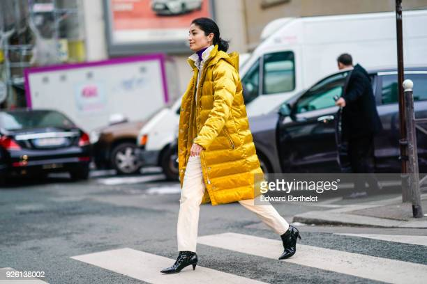 Caroline Issa wears a pink puffer coat black shoes during Paris Fashion Week Womenswear Fall/Winter 2018/2019 on March 1 2018 in Paris France