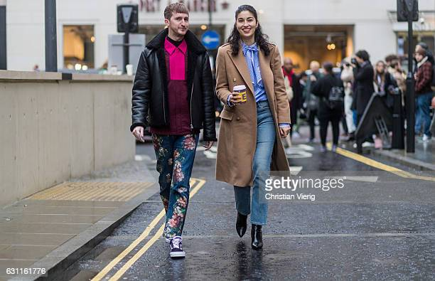 Caroline Issa with a friend during London Fashion Week Men's January 2017 collections at on January 7 2017 in London England