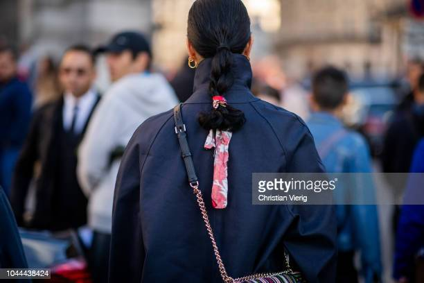 Caroline Issa with scarf in her hair wearing trench coat is seen outside Stella McCartney during Paris Fashion Week Womenswear Spring/Summer 2019 on...