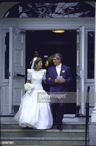 Caroline Kennedy and Edwin Schlossberg emerging from church after wedding ceremony
