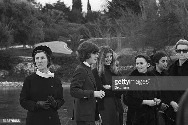 Caroline Kennedy and John Jr wait at Aristotle Onassis' funeral for the arrival of their mother Jacqueline Kennedy Onassis who will be arriving with...