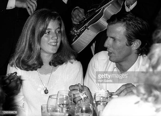 Caroline Kennedy and photographer Peter Beard attend the screening party for Bobby Deerfield on September 18 1977 at Tavern on the Green in New York...