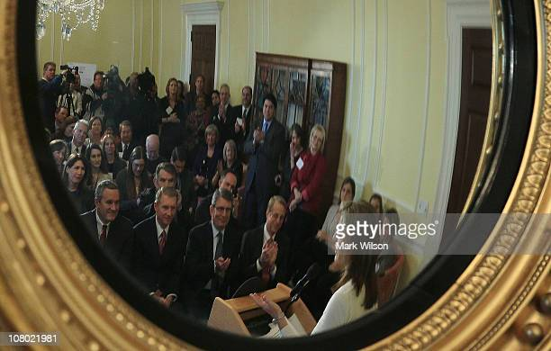 Caroline Kennedy president of the Kennedy Library Foundation is reflected in a mirror while speaking at an event at the National Archives to unveil...