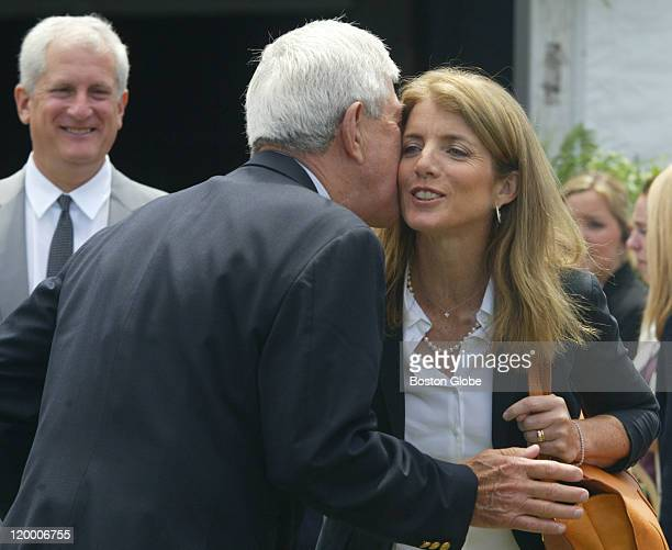 Caroline Kennedy Schlossberg greets a guest at the dedication ceremony Her husband Edwin Schlossberg looks on at left
