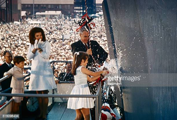 Caroline Kennedy smashes the traditional bottle to christen the aircraft carrier John F Kennedy May 27th 1967 Looking on are Mrs John F Kennedy her...