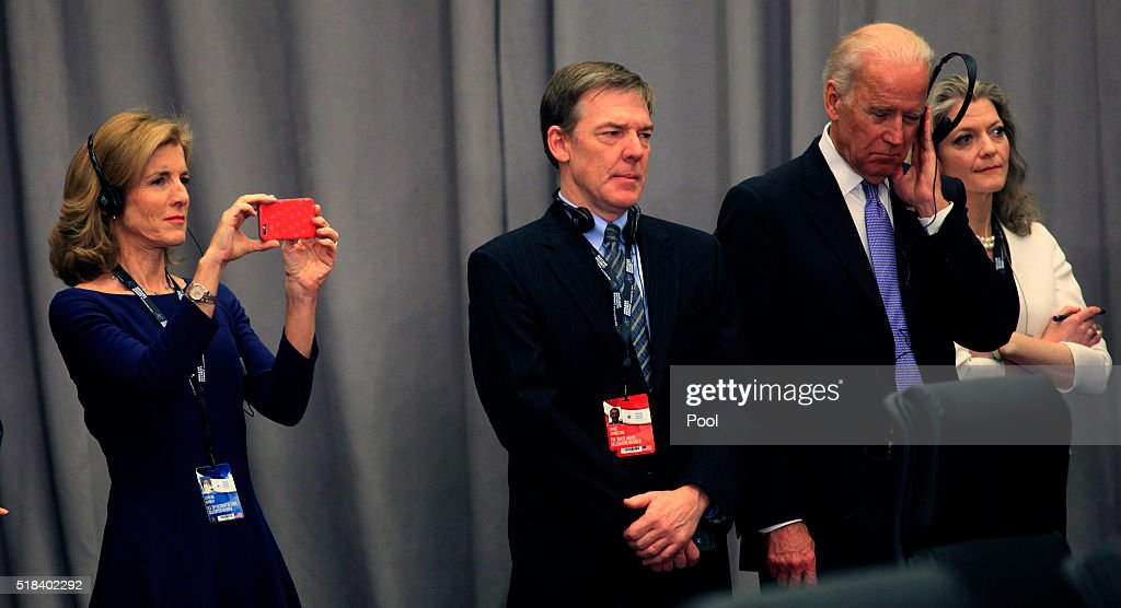 Caroline Kennedy, U.S. Ambassador to Japan, (L) takes a photo alongside Christopher Johnstone, Director for Japan and Oceanian Affairs, Vice President Joe Biden and Allison Hooker, Director for Korea at the NSC during a meeting between President Barack Obama, President Park Geun-Hye of the Republic of Korea and Prime Minister Shinzo Abe of Japan at the Nuclear Security Summit March 31, 2016 in Washington, DC. World leaders are gathering for a two-day conference that will address a range of issues including ongoing efforts to prevent terrorist groups from accessing nuclear material.