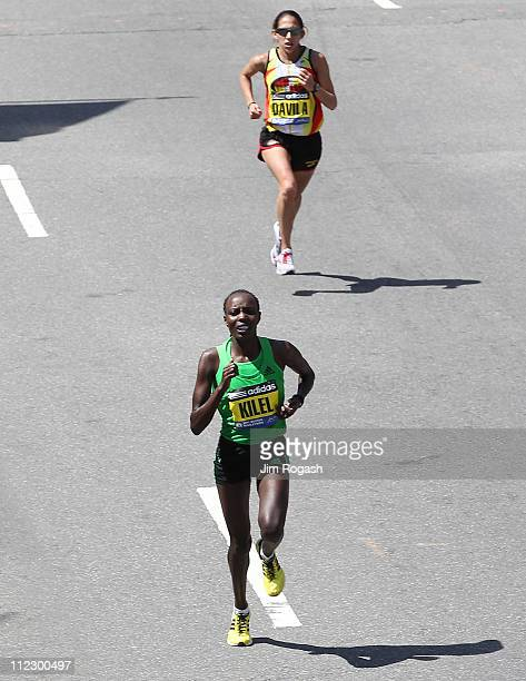 Caroline Kilel of Kenya runs past Desiree Davila of the United States to win the women's division of the 115th running of the Boston Marathon on...