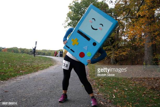 Caroline Kim of Lexington is dressed as BMO a character from the animated show 'Adventure Time' as she stretches before the start of The Costumes for...