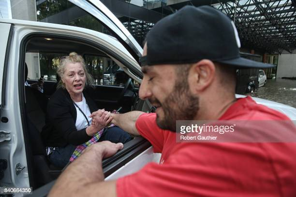 CaroLine Kirkpatrick of Salt Lake City Utah delivers a heartfelt thank you to rescue worker Adam Caballero after he carried her from the Omni Hotel...