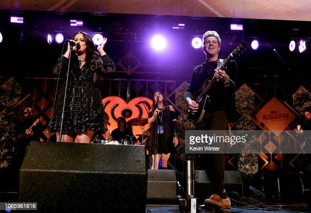 Caroline Kraddick and Ryan Cabrera perform onstage during 1061 KISS FM's Jingle Ball 2018 at American Airlines Center on November 27 2018 in Dallas...