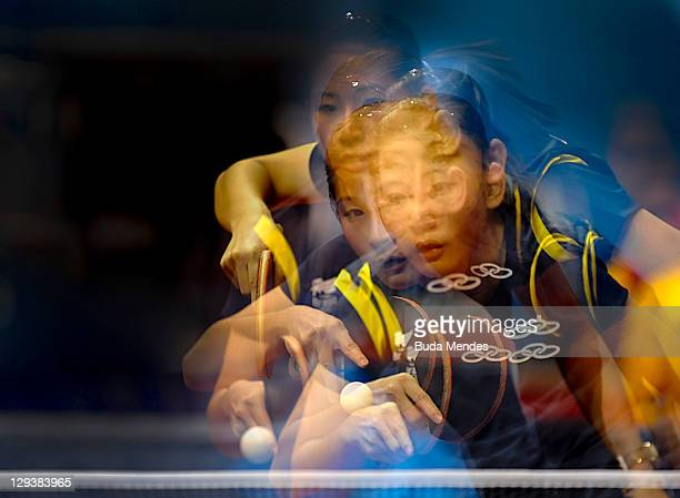 Caroline Kumahara, of Brazil, in competes against Liusa Zuluaga, of Colombia, in the women's singles of table tennis during the Pan American Games...