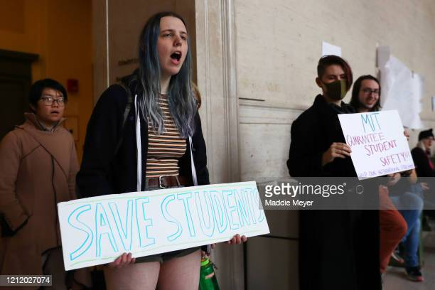 Caroline LaberSmith protests inside Building 10 on the campus of Massachusetts Institute of Technology on March 12 2020 in Cambridge Massachusetts...