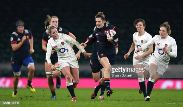 Caroline Ladagnous of France attempts to get away from the English defence during the Women's Six Nations match between England and France at...