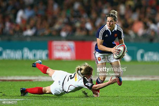 Caroline Ladagnous of France makes a break during the Women's Final match between Canada and France during day one of the 2014 Hong Kong Sevens at...