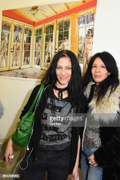 Caroline Lauzain and Paula Marassi attend Lenedy Angot Calendar 2018 launch at Galerie Fabrice Hybert on December 1 2017 in Paris France