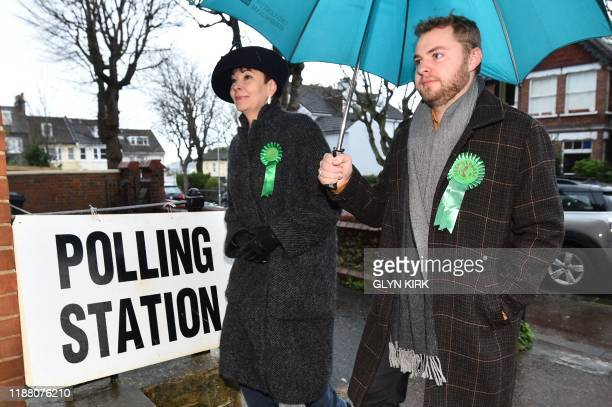 TOPSHOT Caroline Lucas Green MP arrives with her son to cast her vote at a polling station in Brighton south England as Britain holds a general...