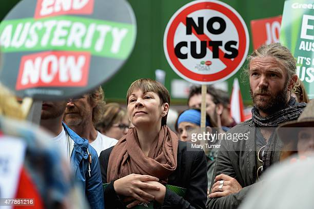 Caroline Lucas MP of the Green Party joins protesters in central London demonstrating against austerity and spending cuts on June 20 2015 in London...