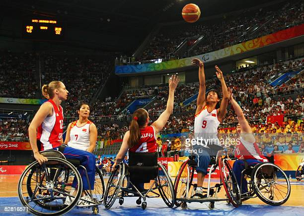 Caroline Maclean of Great Britain completes the ball with Peng Fengling of China in the Wheelchair Basketball match between Great Britain and China...