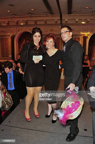 Caroline Manzo poses with the winner of the raffle held during the 2nd annual Posche Fashion Show at The Brownstone on November 2 2010 in Paterson...