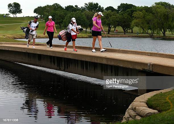 Caroline Masson of Germany and Brittany Lincicome walk onto the eighth green during the second round of the 2013 North Texas LGPA Shootout at the Las...