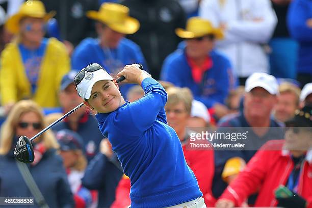 Caroline Masson of the European Team hits the ball at the first tee during the Sundays single matches in the 2015 Solheim Cup at St LeonRot Golf Club...