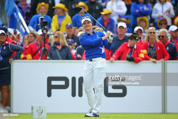 Caroline Masson of the European Team shits the ball at the first tee during the Sundays single matches in the 2015 Solheim Cup at St LeonRot Golf...