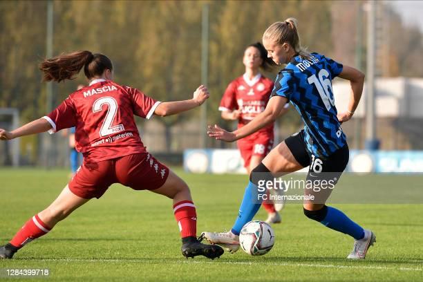 Caroline Moller of FC Internazionale dribbles Angela Mascia of Pink Bari during the Women Serie A match between FC Internazionale and Pink Bari at...