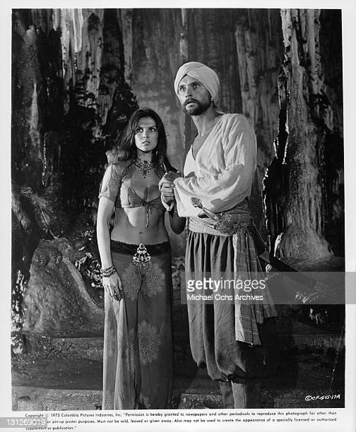 Caroline Munro and John Phillip Law standing outside in the forest in a scene from the film 'The Golden Voyage Of Sinbad' 1973