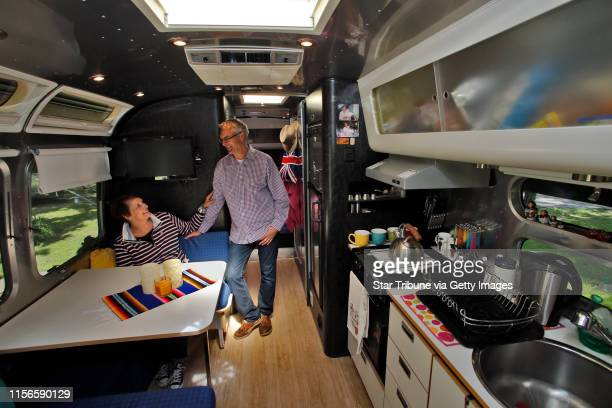 Caroline Munro left and husband Paul Munro in the interior of their Airstream designed by Christopher Dean ] Profile of Airstream trailer owners...