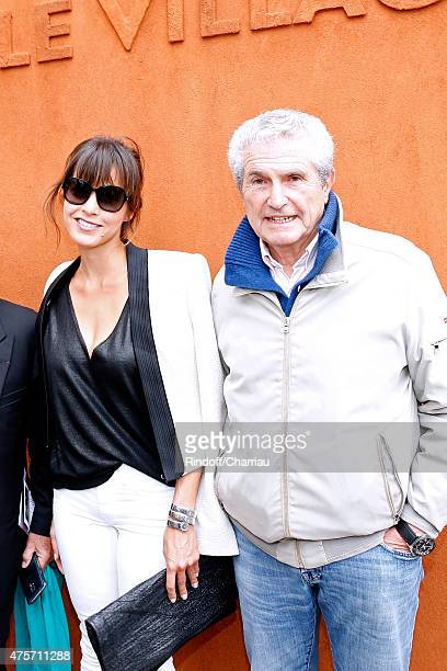 Caroline Nielsen and Claude Lelouch attend the 2015 Roland Garros French Tennis Open Day Eleven on June 3 2015 in Paris France