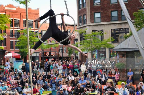 Caroline OdlinBrewer 16 of Circus Maine performs on a Lyra during Square Hop at Congress Square Park Friday June 9 2017