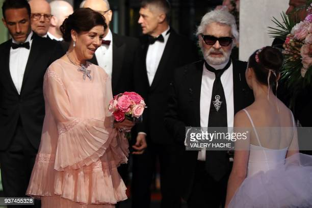 Caroline of Monaco Princess of Hanover and German fashion designer Karl Lagerfeld arrive for the annual Rose Ball at the MonteCarlo Sporting Club in...