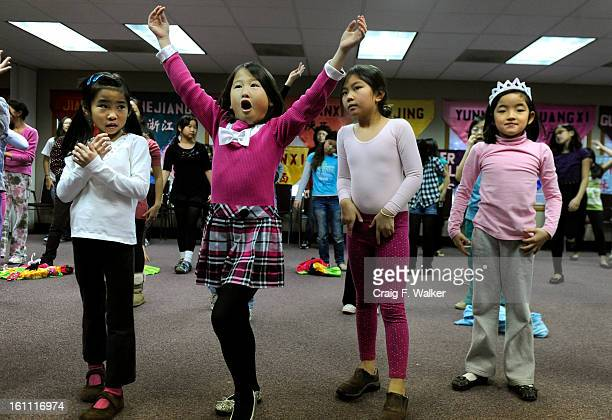 Caroline Oppelt Isabella Martinez Olivia Spencer and Alea Brown take part in a rehearsal for the upcoming New Year celebration at the Chinese...