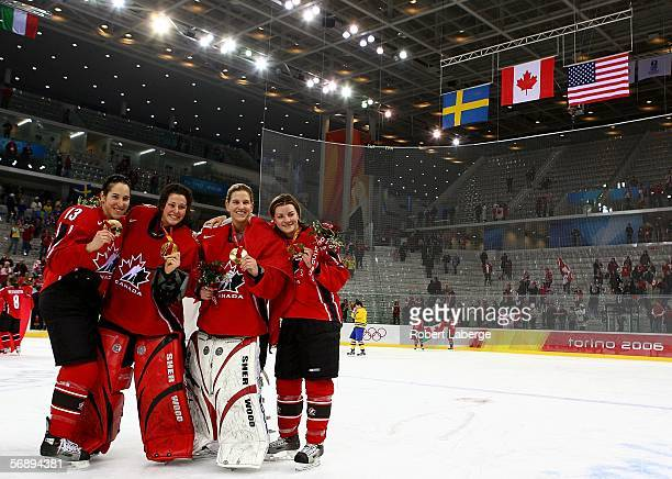 Caroline Ouellette, Charline Labonte, Kim St-Pierre and Sarah Vaillancourt of Canada pose for a picture after receiving the gold medal following...