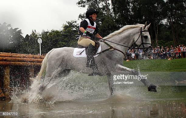 Caroline Powell of New Zealand and Lenamore go through the water jump during the Eventing Cross Country event held at the Hong Kong Olympic...