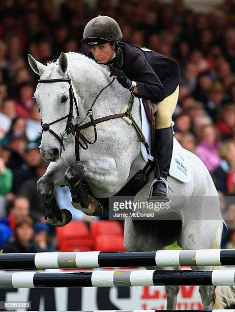 Caroline Powell of New Zealand rides Lenamore over a jump during the Show Jumping on the fourth day of the Badminton Horse Trials on May 4 2008 in...