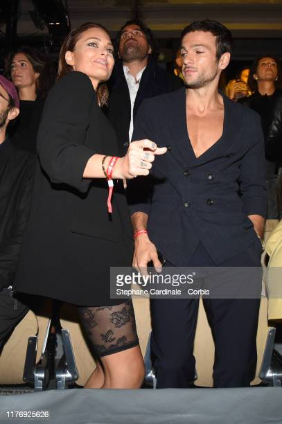 Caroline Receveur and her companion Hugo Philip attend the Etam Winter 2019/Summer 2020 show as part of Paris Fashion Week on September 24 2019 in...