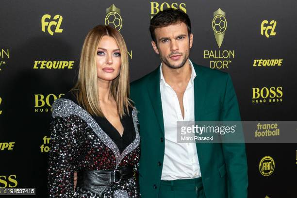 Caroline Receveur and Hugo Philip attend the photocall during the Ballon D'Or Ceremony at Theatre Du Chatelet on December 02, 2019 in Paris, France.