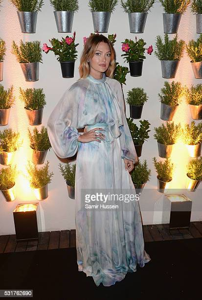 Caroline Receveur attends The Harmonist Cocktail Party during the 69th annual Cannes Film Festival at the Plage du Grand Hyatt on May 16 2016 in...