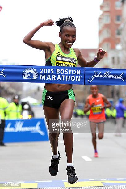 Caroline Rotich of Kenya crosses the finish line to win the 119th Boston Marathon on April 20 2015 in Boston Massachusetts